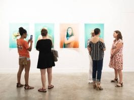 """The 2018 Crit Group exhibition at GrayDuck Gallery with Christa Blackwood's """"Boy Play"""" photographs. Photo: The Contemporary Austin"""