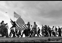 marchers line the horizon en route from Selma to Montgomery, Alabama. © 1965 Matt Herron, Courtesy CDEA.