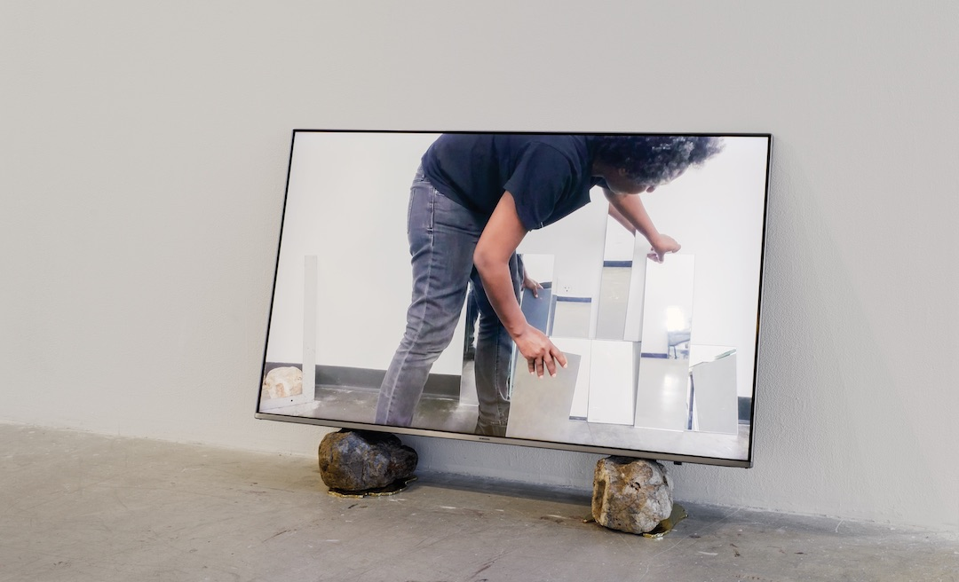 Betelhem Makonnen, perception conjugation, 2019 Video w/sound, monitor, rocks, gold shadows 17:52 mins. Photo by Dan Miller.