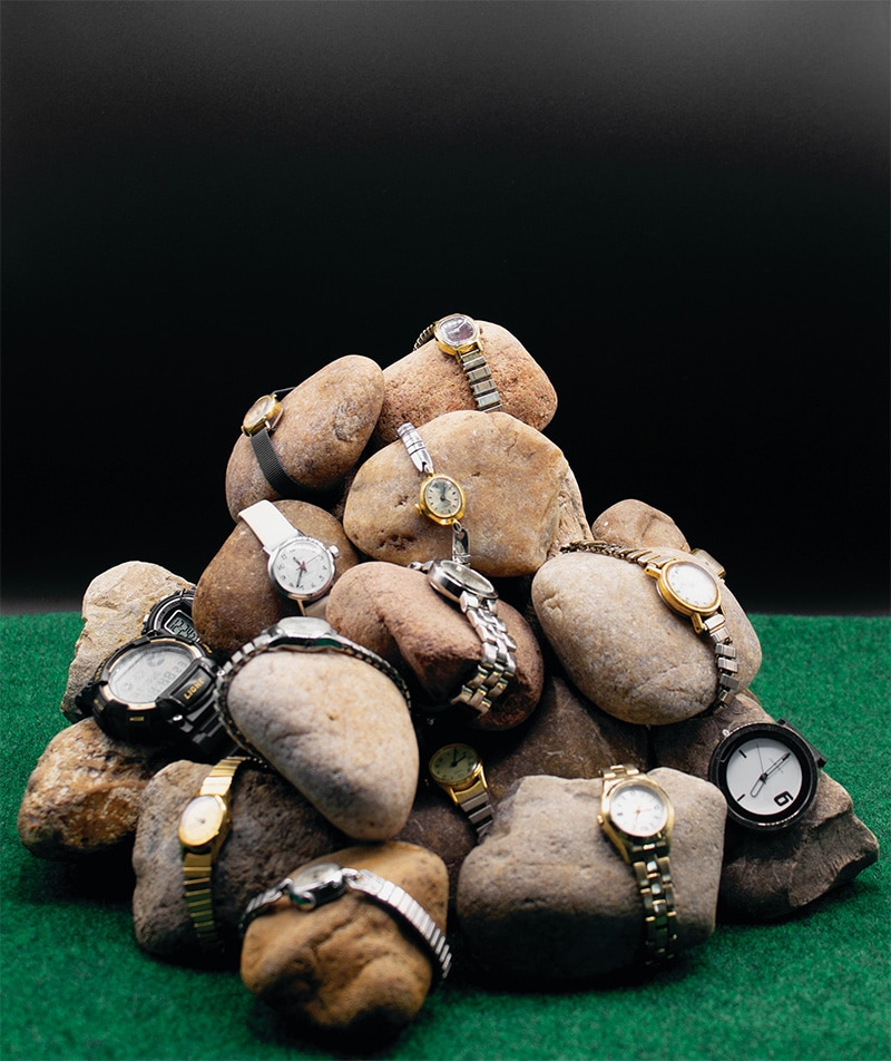 untitled (our misunderstanding of time, of ourselves) 2020 Rocks, watches, simulacrum grass Image courtesy of the artist