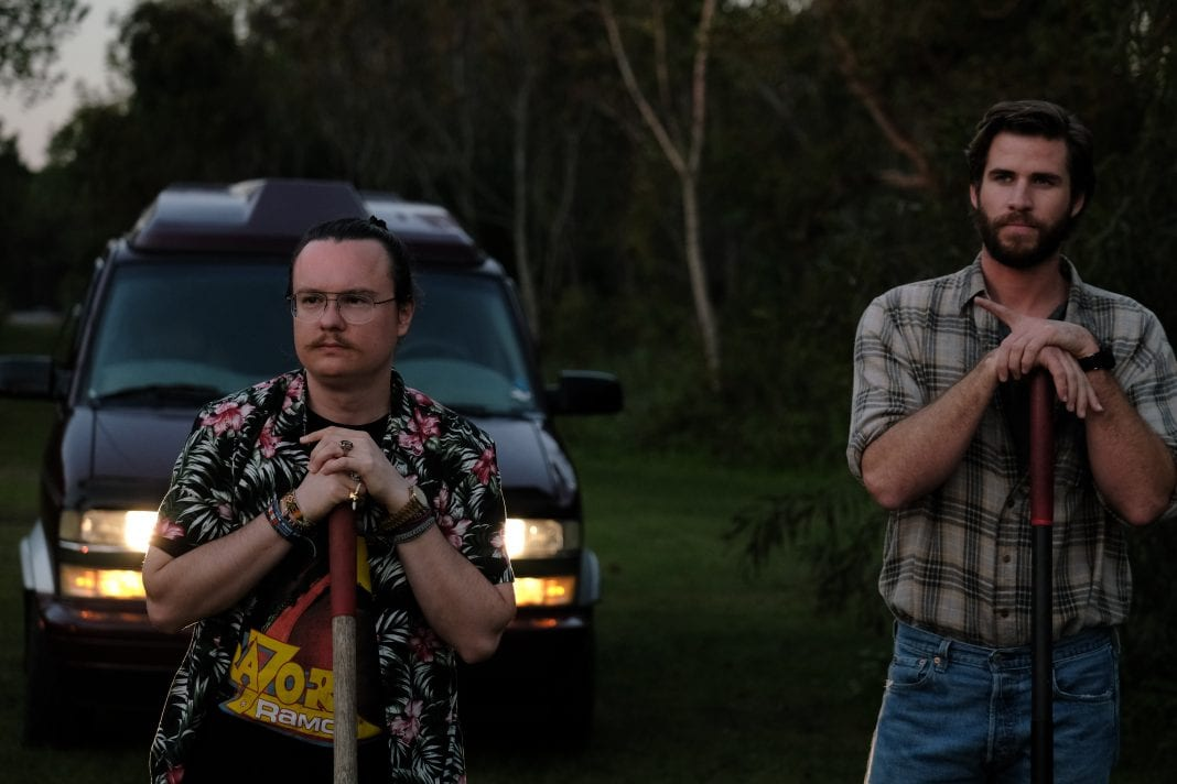 Clark Duke plays Swin, and Liam Hemsworth is Kyle in