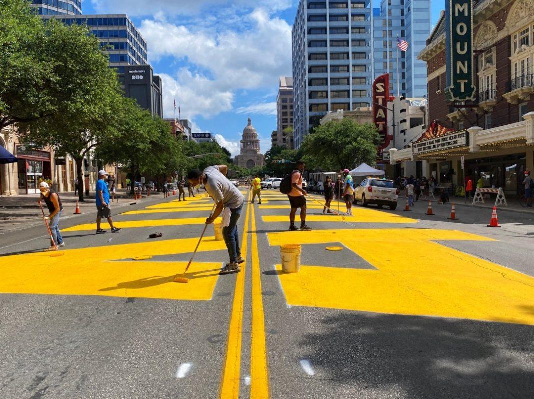 Artists paint 'Black Austin Matters' on Congress Avenue. Photo: Downtown Austin Alliance.
