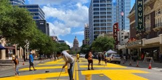 Artists paint 'Black Austin Matters' on Congress Avenue. Photo: Downtown Austin Alliance.