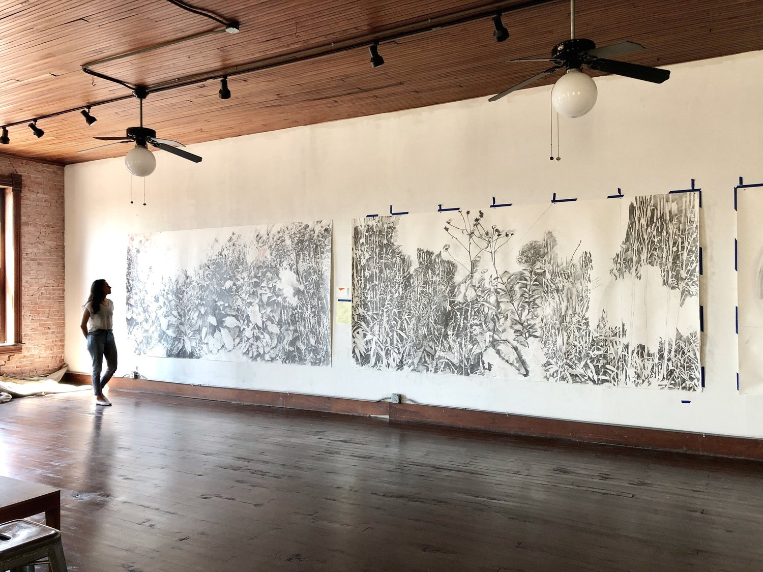 Austin artist Rachel Wolfson Smith, a 2019 resident, with her large-scale drawings at 100W.