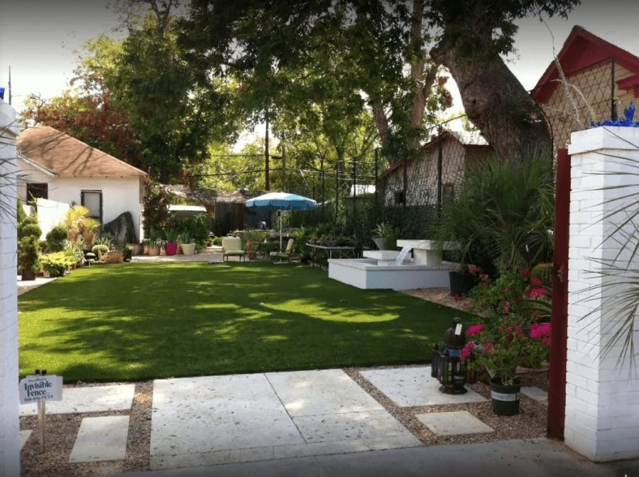 The courtyard — seen here in use by the former tenant, the landscape design business Big Red Sun — opens to E. Cesar Chavez St. The house on the left is part of the parcel purchased by Women & Their Work.