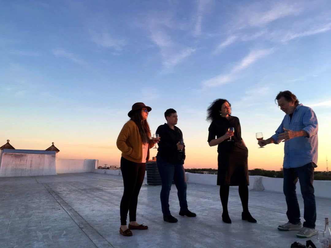 Residents of 100W on the building's rooftop.
