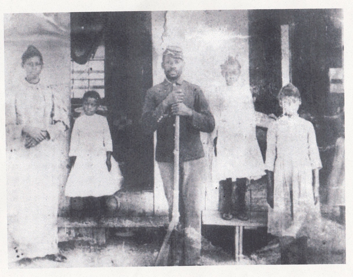 Family in front of the Hezikah Haskell house in Clarksville, believed to be Haskell himself, his wife Catherine, and their three children.