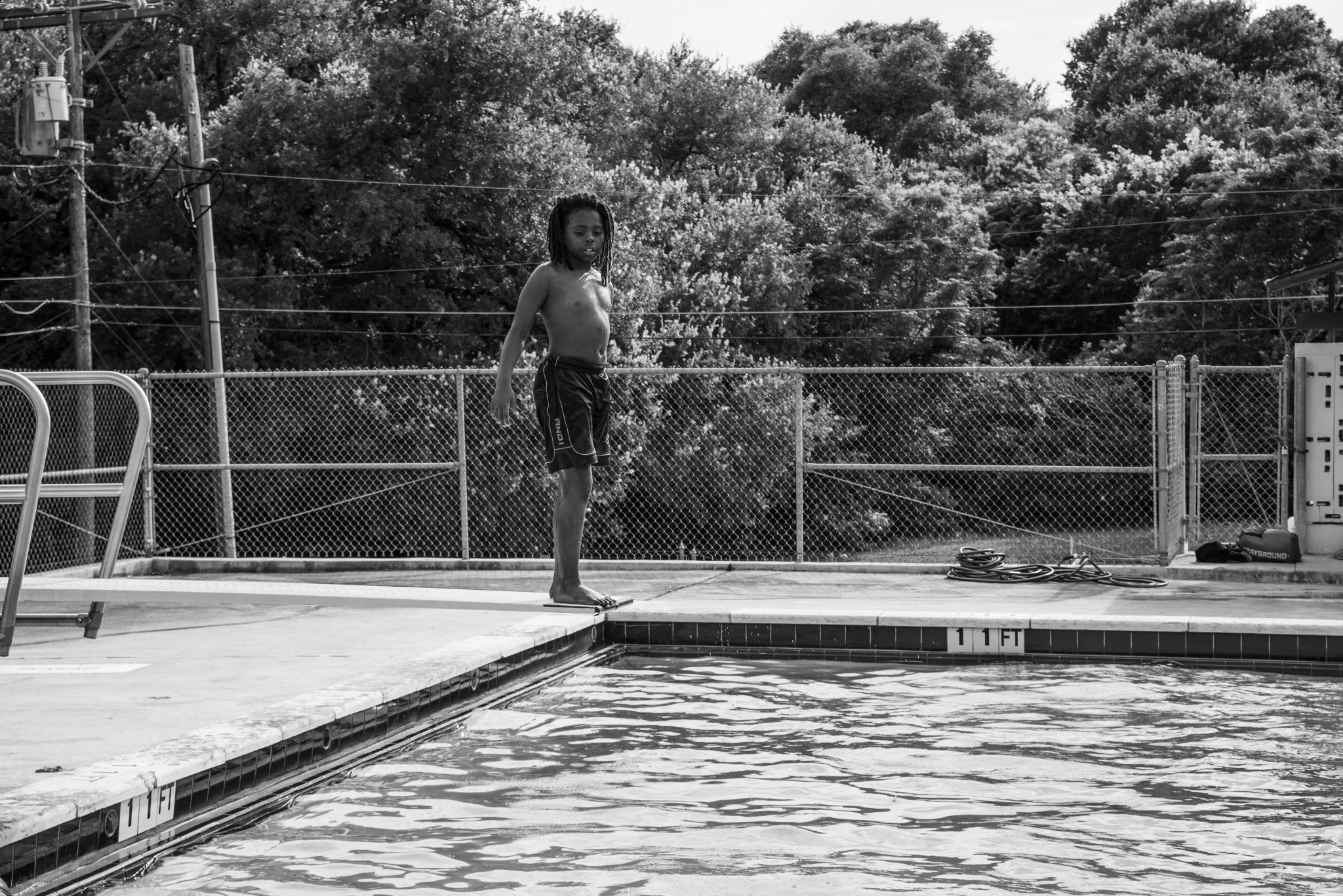 "Cindy Elizabeth, ""Boy prepares to jump off the diving board at Givens Pool, Austin, Texas."" 2019. Digital photograph. @Cindy Elizabeth"
