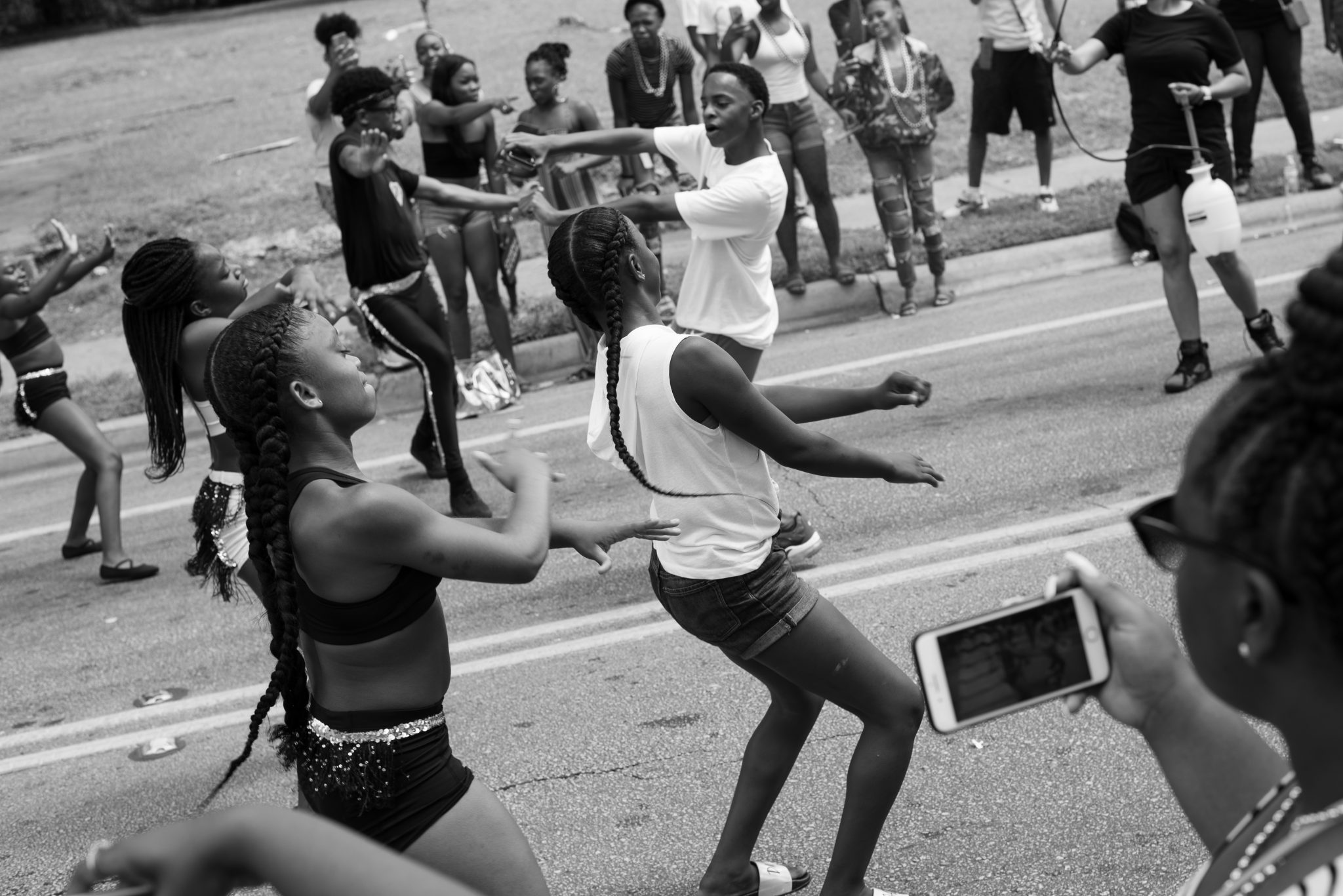 "Cindy Elizabeth, ""A drill team performs a routine during the Juneteenth Parade, Austin, Texas."" 2019. Digital photograph. @Cindy Elizabeth"