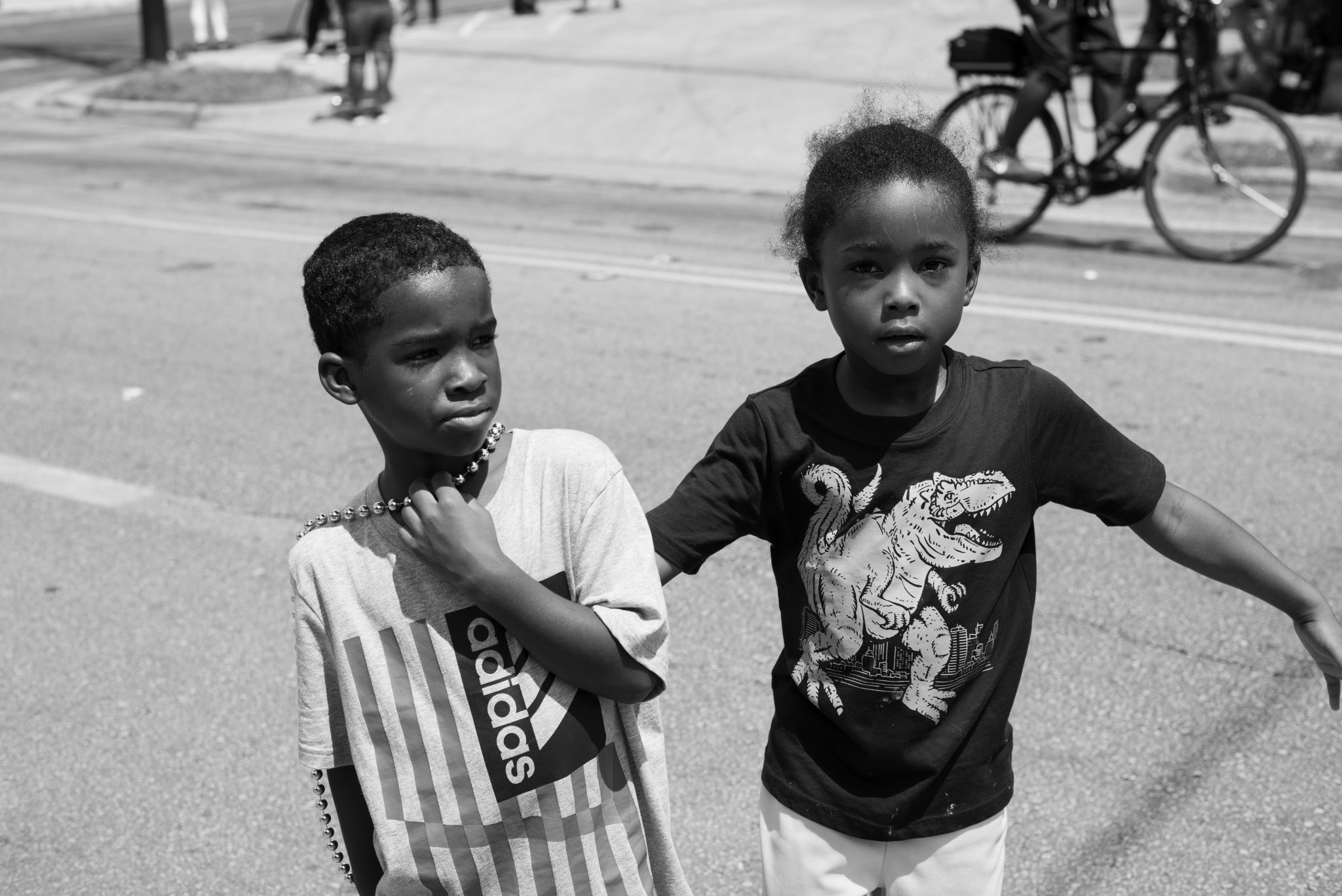 "Cindy Elizabeth, ""Children hang out and collect candy and beads during the Juneteenth Parade, Austin, Texas."" 2019. Digital photograph. @Cindy Elizabeth"