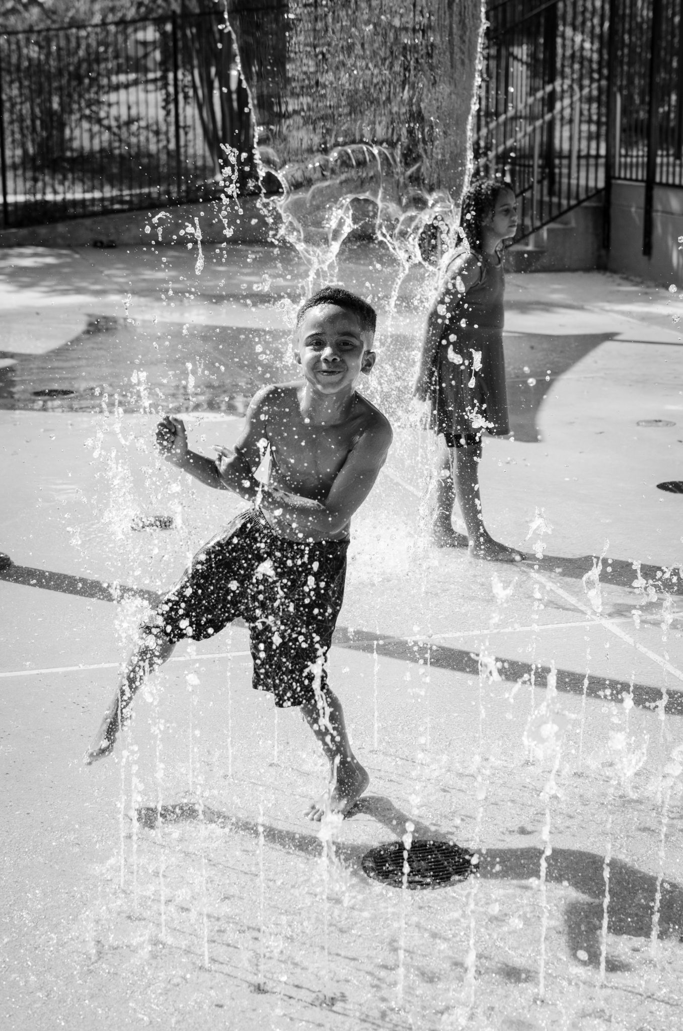 "Cindy Elizabeth, ""Yuree McKoy splashes in a fountain at the Rosewood Park splashpad, Austin, Texas."" 2015. Digital photograph. @Cindy Elizabeth"