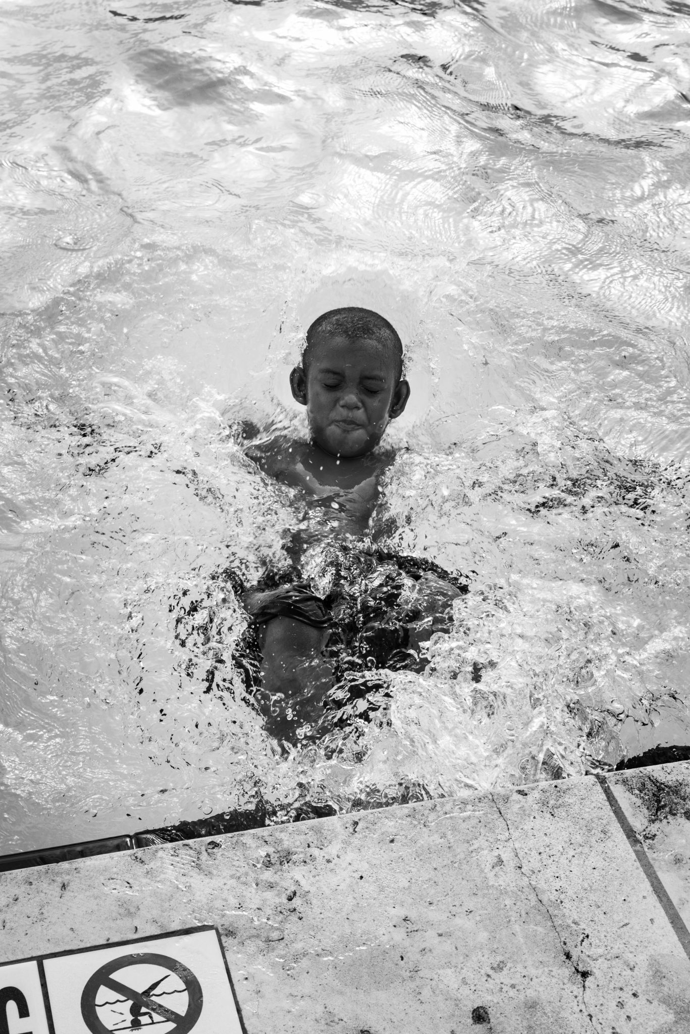 "Cindy Elizabeth, ""Boy splashes around in Givens Pool, Austin, Texas."" 2019. Digital photograph. @Cindy Elizabeth"