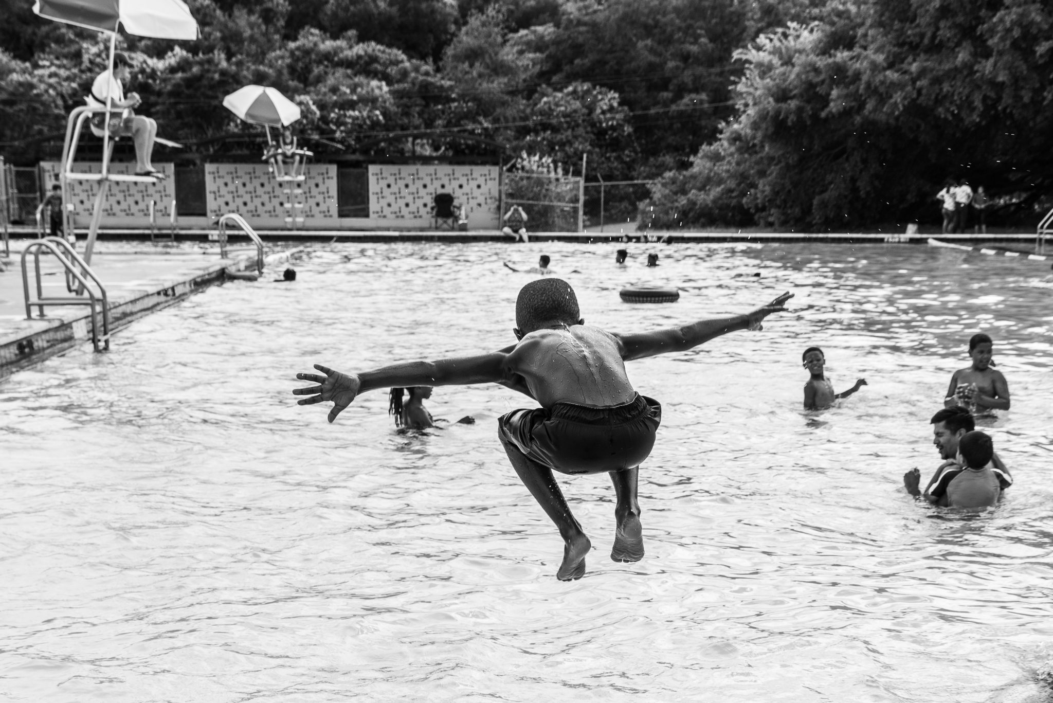 """Cindy Elizabeth, """"Boy flys into Givens Pool, Austin, Texas."""" 2019. Digital photograph. @Cindy Elizabeth"""