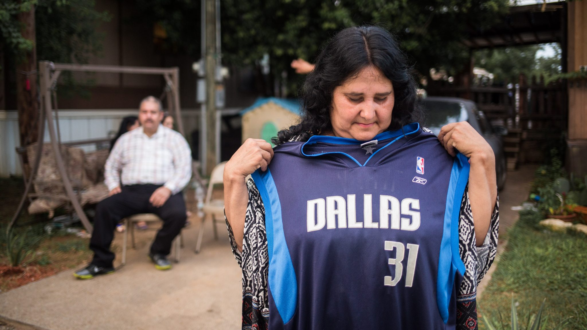 Graciela Granillo. mother of fallen worker, Roendy Granillo, holds his favorite basketball jersey. Photo by Moyo Oyelola.