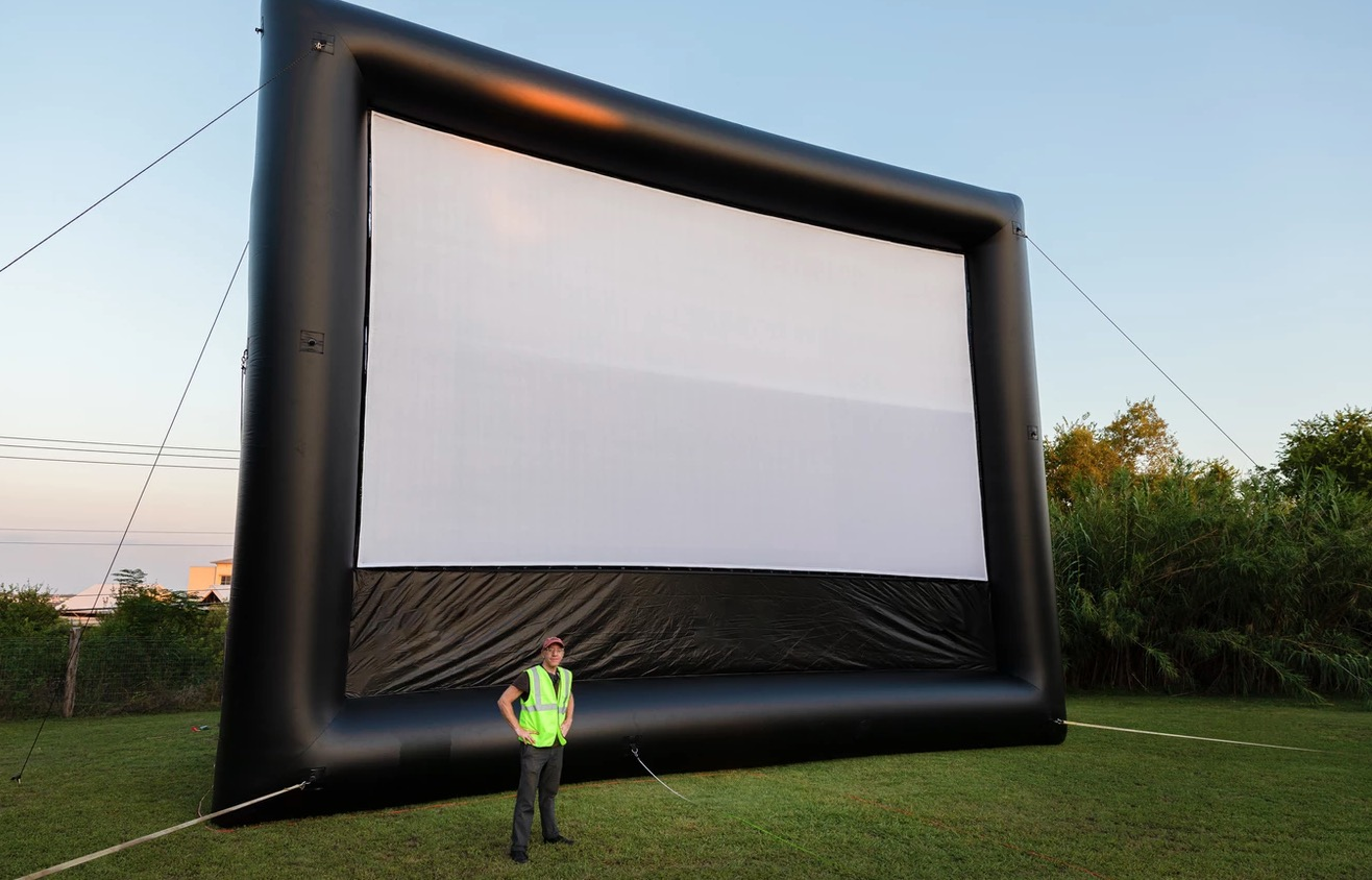Justin Sherburn with his 40-foot inflatable, portable movie screen.