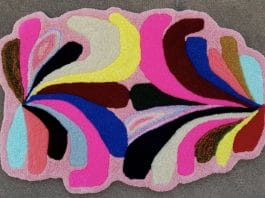 Rachel Comminos, Untitled, 2020, hand tufted original design, yarn on Monks cloth and hand sewn edges, 26 x 39 inches.