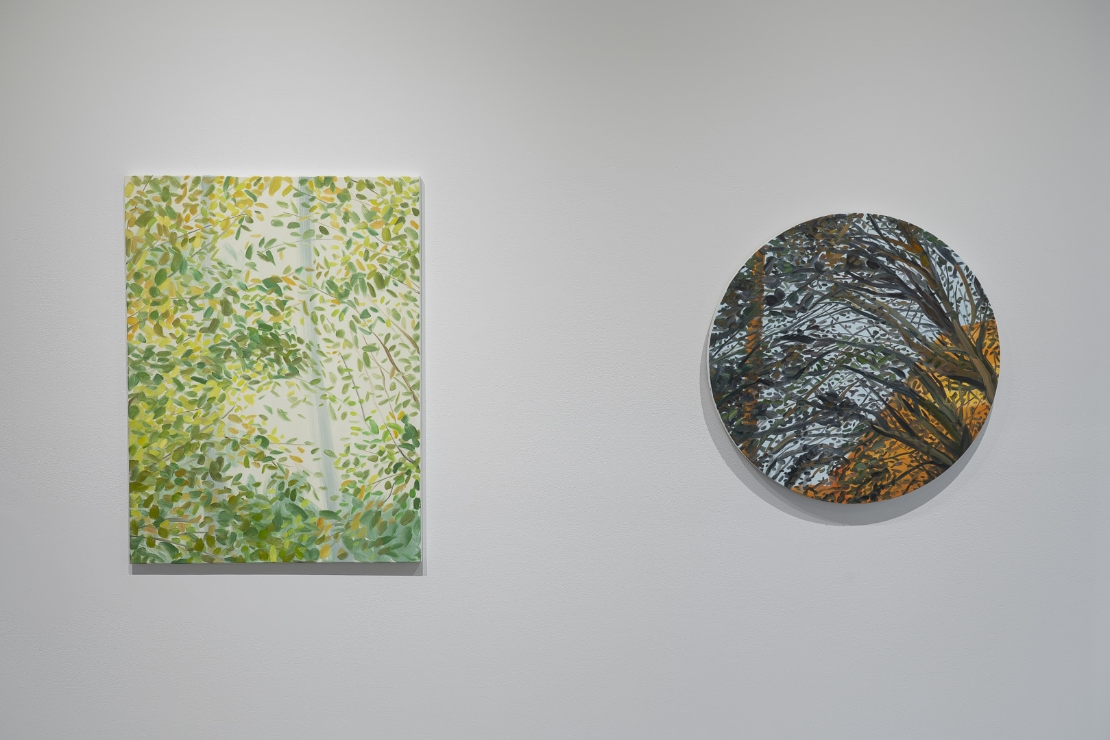 "Installation view of Julie DeVries, ""Leaves For You"" (left) and ""Leaves at Sunset"" (right). Courtesy Grayduck Gallery."