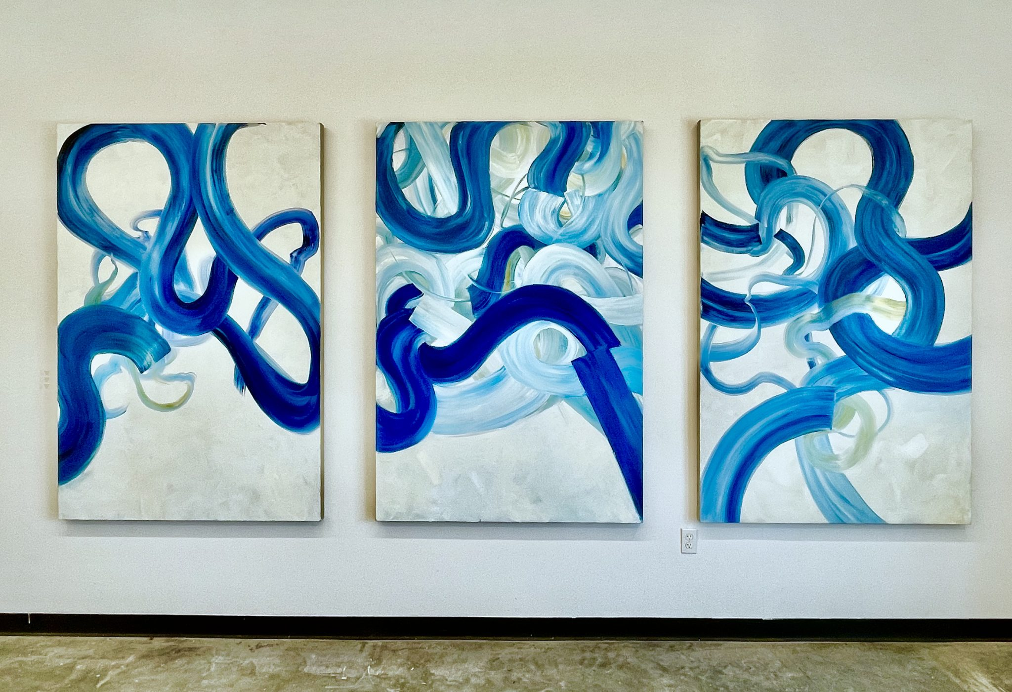 "Installation view of Sydney Yeager's ""The Hours #1, #2, #3,' oil on linen."