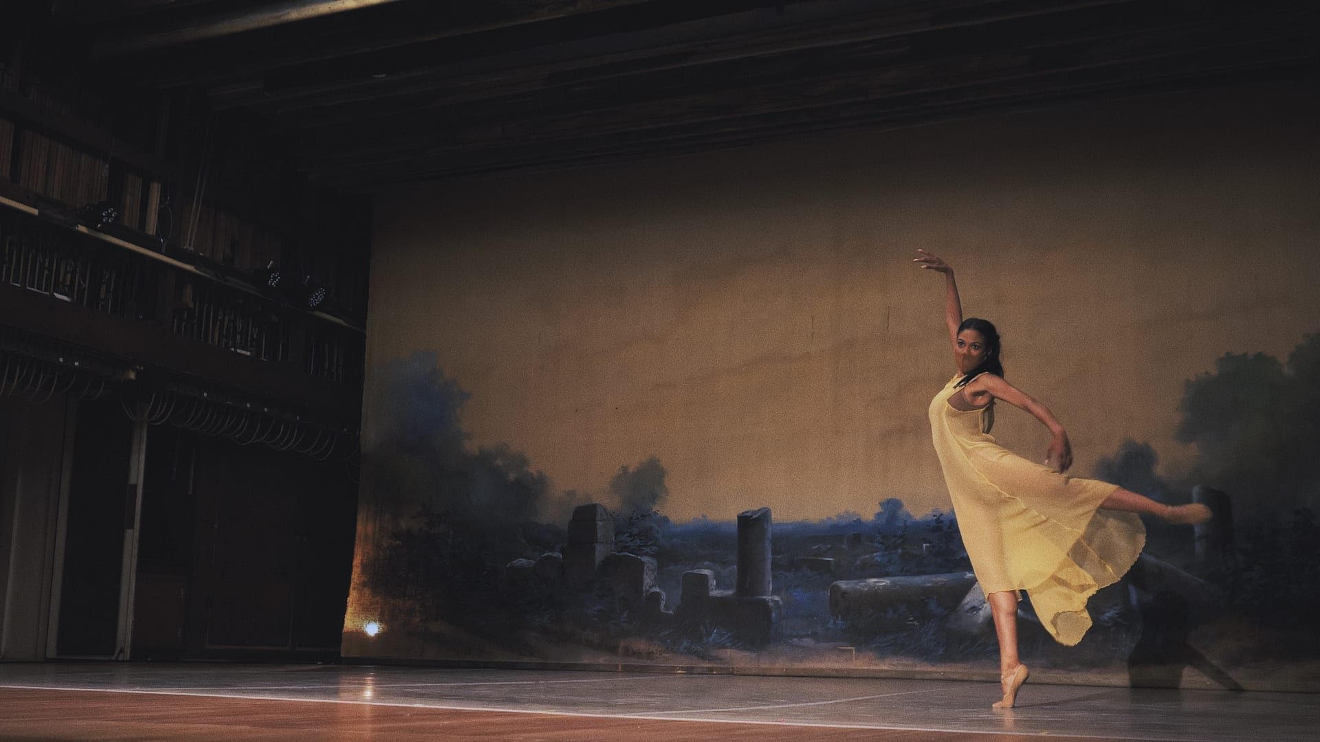 """Ballet Austin dancer Courtney Holland in """"Preludes/Beginning,"""" with choreography by Stephen Mills. Film still by Paul Michael Bloodgood and Jordon Moser."""