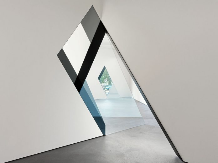 SARAH OPPENHEIMER, 33-D, 2014. Aluminum, glass and existing architecture. Total dimensions variable. Location: Kunsthaus Baselland. Photo credit: Serge Hasenböhler.