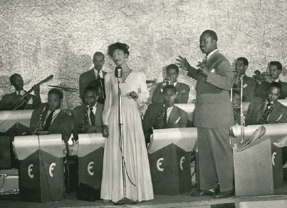 Stella sings with the Ernie Fields Orchestra