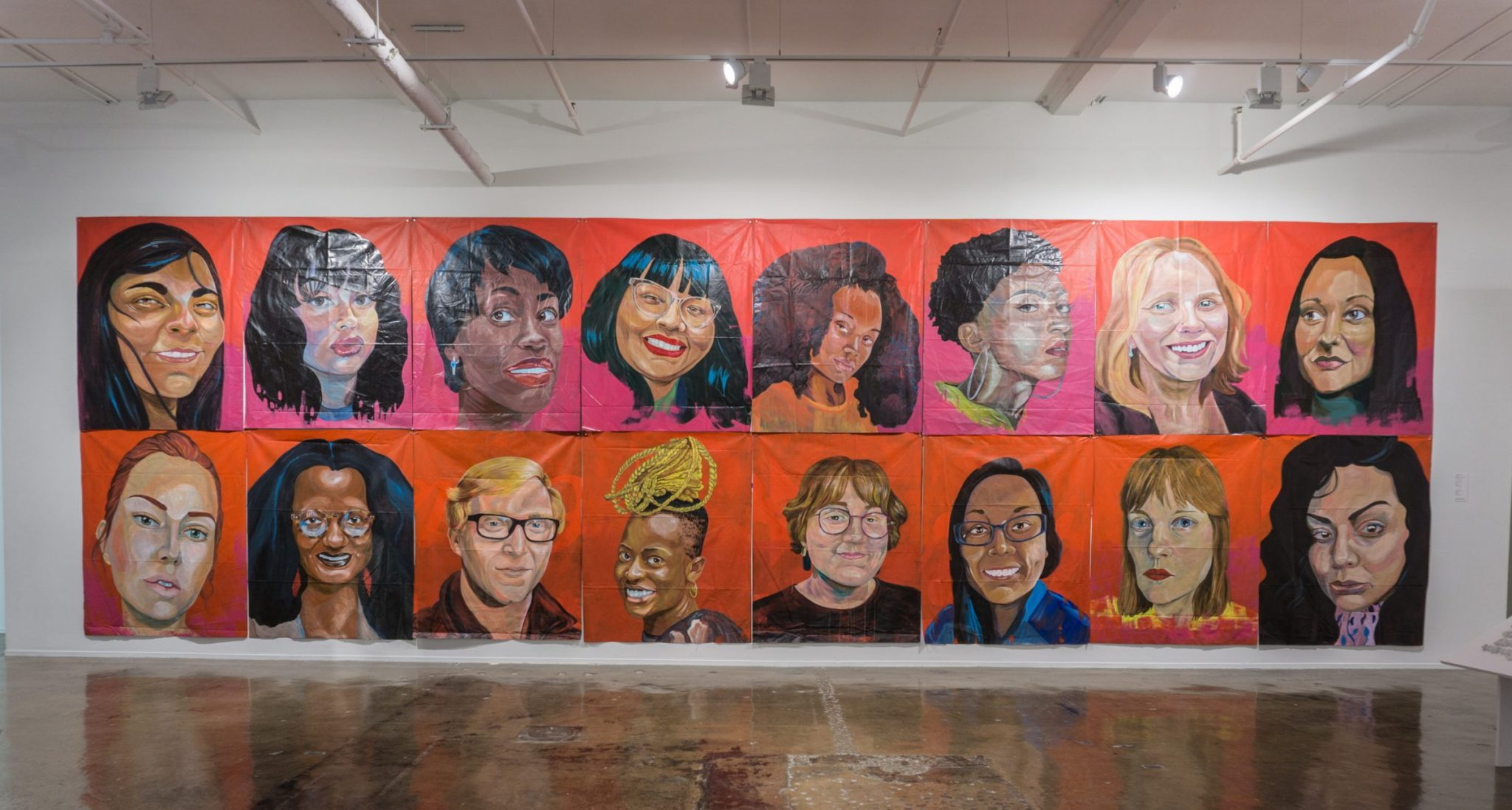 """Installation of Madison Cowles Serna's """"Withstand,"""" 2021, Acrylic on used billboard vinyl, 8' x 27' Courtesy of the artist and Blue Star Contemporary"""