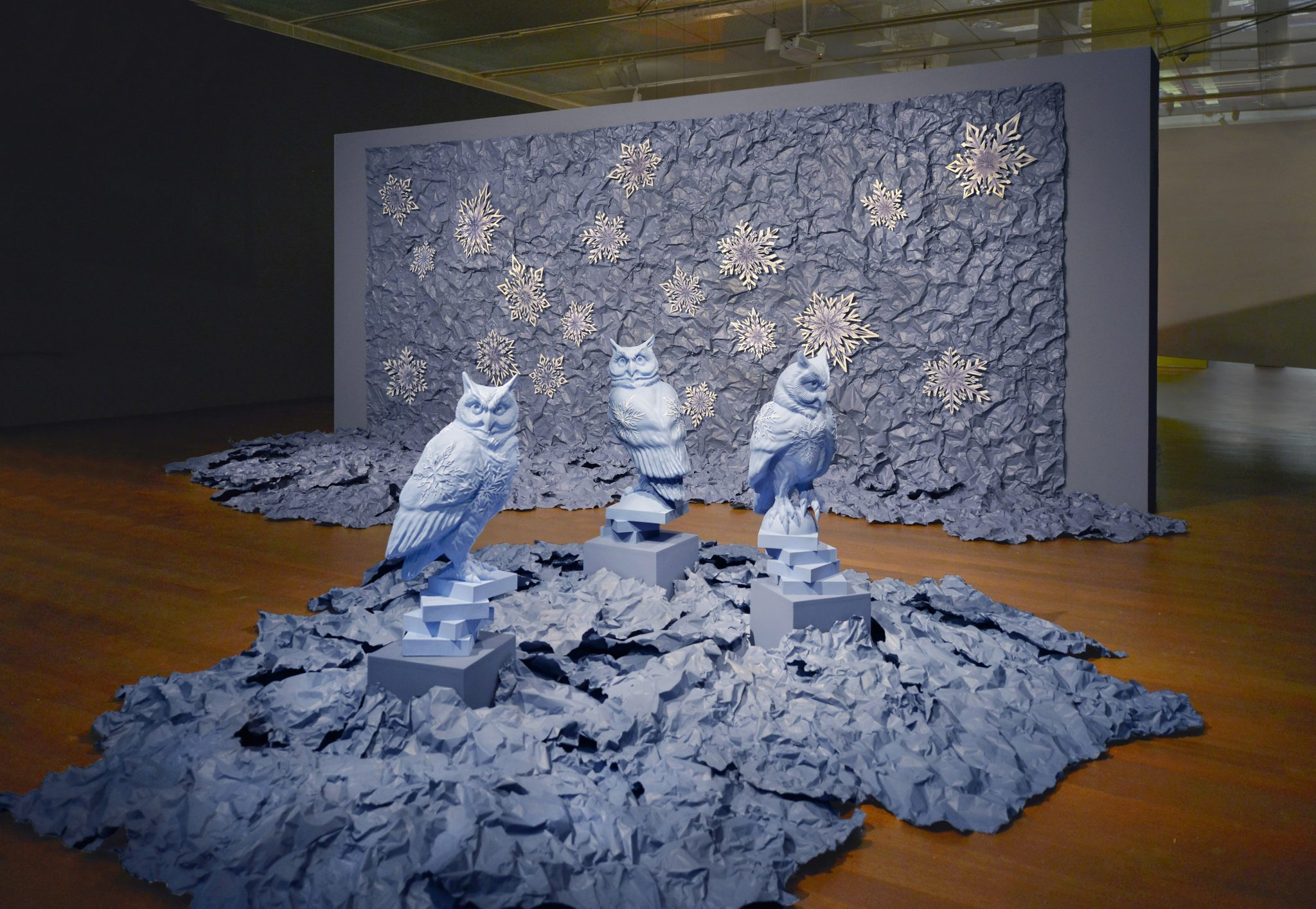 """Sandy Skoglund, """"Winter,"""" 2020. Installation includes four statues, 18 snowflakes and painted foil.  Artist's Courtesy and the McNay Museum of Art."""